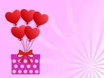 Romantic gift of balloons in the shape of a heart on a gentle pink background.  royalty free stock photo