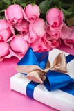 Romantic gift box. With wet roses in back Royalty Free Stock Image