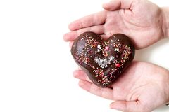Romantic gift. Chocolate heart lies on palm of your hand Royalty Free Stock Photo