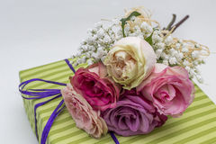 Romantic gift decorated with roses, closeup shot Royalty Free Stock Photos