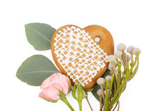 Romantic gift: Ginger heart-shaped cookie with flowers isolated Royalty Free Stock Photo