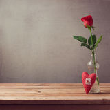 Romantic gift of rose flower and heart shape on wooden table with copy space Stock Photo