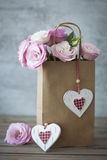 Romantic Gift with Roses and Hearts Royalty Free Stock Photography