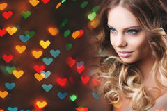 Romantic girl  on a background of hearts Royalty Free Stock Images