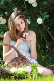 Romantic girl with a basket of flowers Stock Photos
