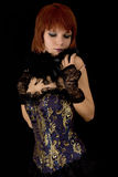 Romantic girl in blue corset with feather boa. Isolated on black background Stock Photos