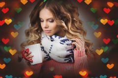Romantic girl with a cup of coffee on a background of hearts Stock Image