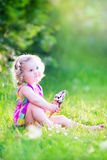 Romantic girl eating ice cream in the garden Stock Image