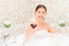 Romantic girl with a glass of wine in the jacuzzi Stock Photography