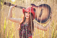Romantic girl and guitar. Summer Stock Image
