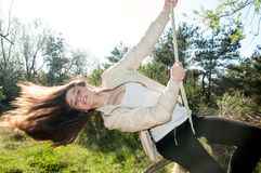 Romantic girl having fun on a swing Stock Images