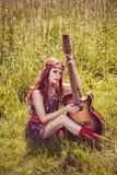 Romantic girl holding her guitar Stock Photo