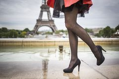 Romantic girl legs in healed shoes eifel tower Paris. Woman street fashion style outdoor in France eifel tower Royalty Free Stock Image