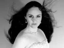 Romantic girl with long thick dense hair Stock Photos