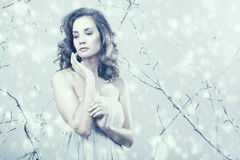 Romantic girl looking away in dress on winter fantasy set up Royalty Free Stock Image