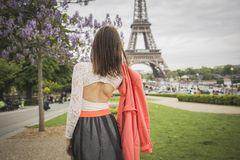 Romantic girl is looking at eifel tower Royalty Free Stock Images