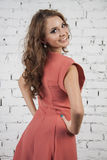 Romantic Girl in luxurous pink dress looking back Royalty Free Stock Images