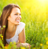 Romantic girl lying on summer field Stock Photos