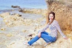 Romantic girl near the sea Stock Photos