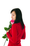 The romantic girl with a pink rose Royalty Free Stock Photos