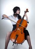 Romantic girl playing cello Stock Image
