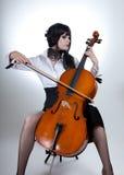 Romantic Girl Playing Cello Stock Image