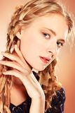 Romantic girl. Portrait of a charming blonde woman posing in studio Royalty Free Stock Photography