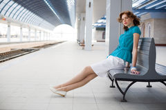 Romantic girl on railway station Stock Images