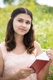 Romantic girl reading a book on nature Royalty Free Stock Photos
