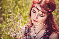 Romantic girl with rose headband Stock Photos