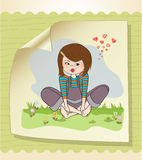 Romantic girl sitting barefoot in the grass Stock Photo