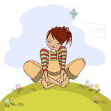 Romantic girl sitting barefoot in the grass Royalty Free Stock Photos