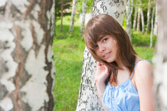 The Romantic girl stands near to a birch Royalty Free Stock Photos