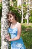 The Romantic girl stands near to a birch Stock Photography