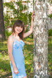 The Romantic girl stands near to a birch Stock Image