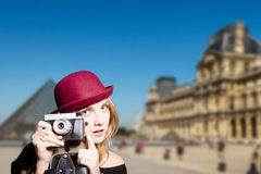 Romantic girl in sunglasses holding retro camera Royalty Free Stock Photo