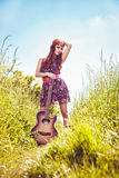 Romantic girl travelling with her guitar Royalty Free Stock Photo
