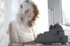 Romantic girl is typing Stock Images