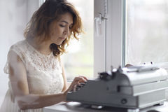 Romantic girl is typing Royalty Free Stock Image