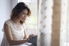Romantic girl is typing Royalty Free Stock Photography