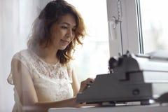 Romantic girl is typing Stock Photo
