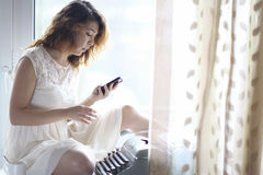 Romantic girl is typing Royalty Free Stock Photos