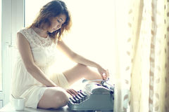 Romantic girl is typing Royalty Free Stock Photo