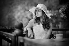 Romantic girl waiting on the terrace Royalty Free Stock Photo