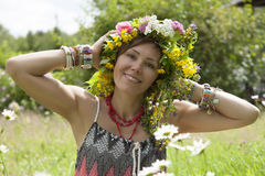 Romantic girl in a wreath of wild flowers Royalty Free Stock Image
