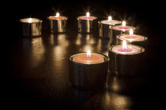 Romantic Glow. A number of tealight candles in a semi circle creating a romantic glow Stock Image