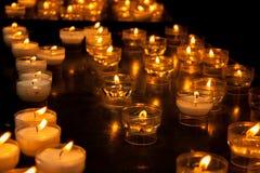 Romantic glowing long row of candlelight burning Stock Photos