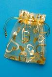 Romantic golden gift bag Royalty Free Stock Photos