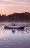 Romantic golden sunset river lake fog loving couple small rowing boat date beautiful Lovers ride during Happy woman man together r Stock Photos
