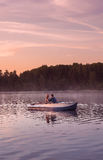 Romantic golden sunset river lake fog loving couple small rowing boat date beautiful Lovers ride during Happy woman man together r Royalty Free Stock Images